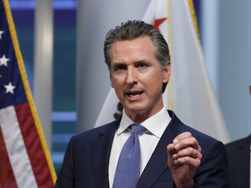 California Gov. Gavin Newsom gives an update to the state's response to the coronavirus, at the Governor's Office of Emergency Services in Rancho Cordova, Calif., on Tuesday.