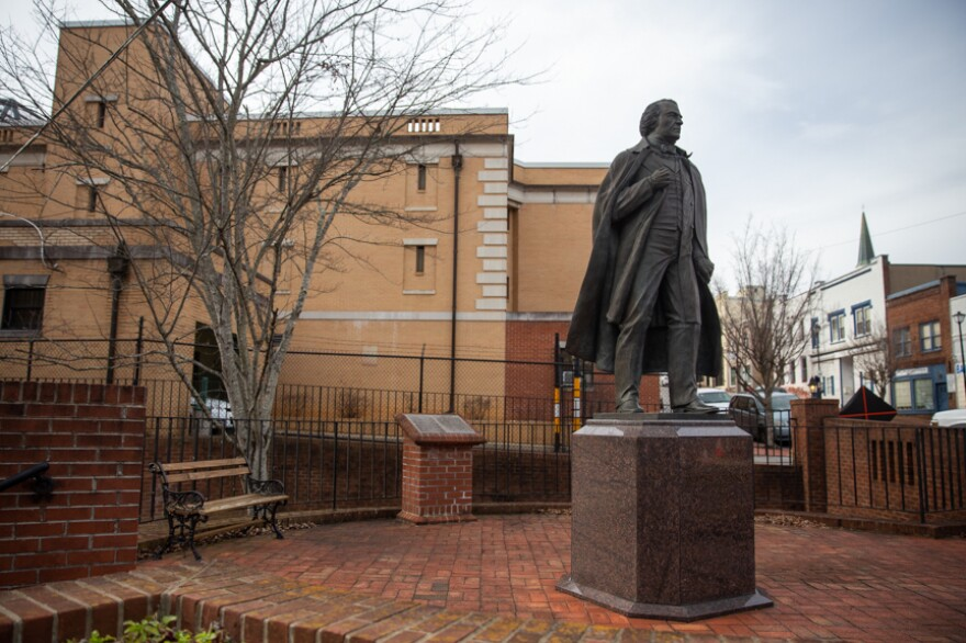 A statue of 17th president of the United States, Andrew Johnson, stands outside of the Greene County Jail in Greeneville, Tenn.