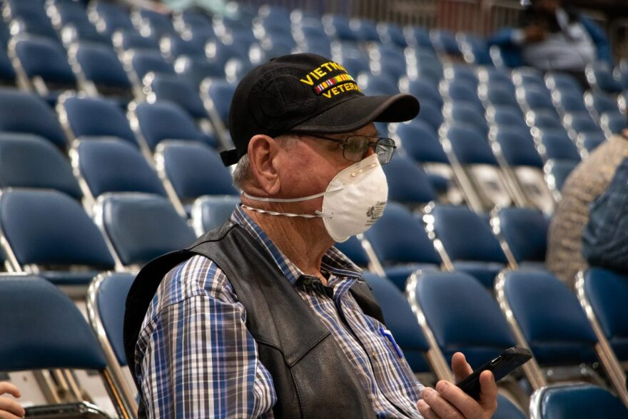 A person wears a mask at the Houston Rodeo on March 9, 2020.