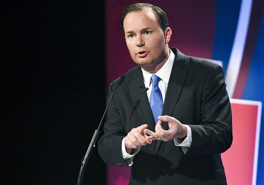 Photo of a man speaking on stage