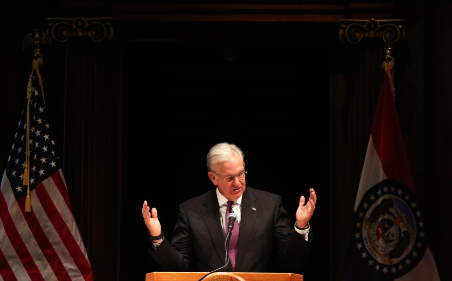 Gov. Jay Nixon speaks to reporters following the end of the legislative session in Jefferson City on Friday.