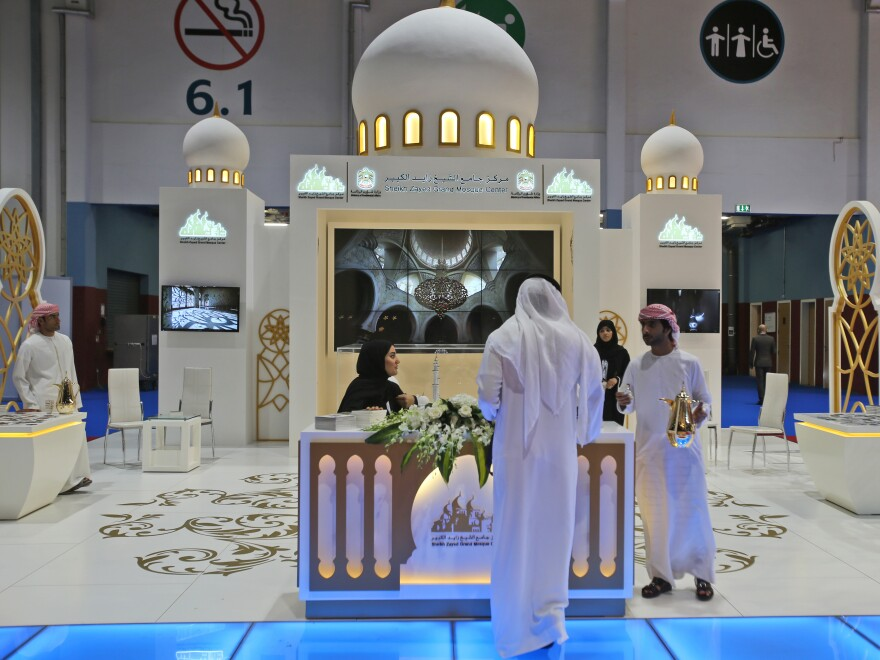 An exhibitor offers traditional Arabic coffee to a visitor during the opening day of the 2015 World Halal Travel Summit in Abu Dhabi, United Arab Emirates. Halal tourism is growing as the hospitality industry seeks ways to better serve Muslim travelers, from providing alcohol-free venues to swimming areas that are segregated by gender.