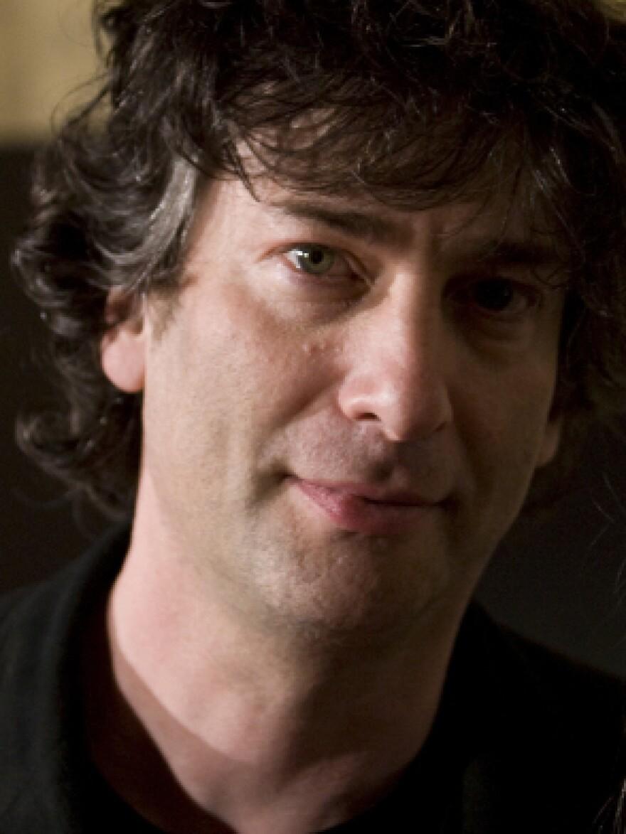 """<p><a href=""""http://www.neilgaiman.com/"""">Neil Gaiman</a> is also the author of <em><em>Coraline</em></em><em>,</em><em> Amer<em>ican Gods</em>, <em>Anansi Boys</em>,<em>Stardust</em> </em>and<em> <em>M Is for Magic</em>. </em>He was born in Hampshire, England, and now lives near Minneapolis. You can follow him on Twitter <a href=""""http://twitter.com/#!/neilhimself"""">@neilhimself</a>.</p>"""