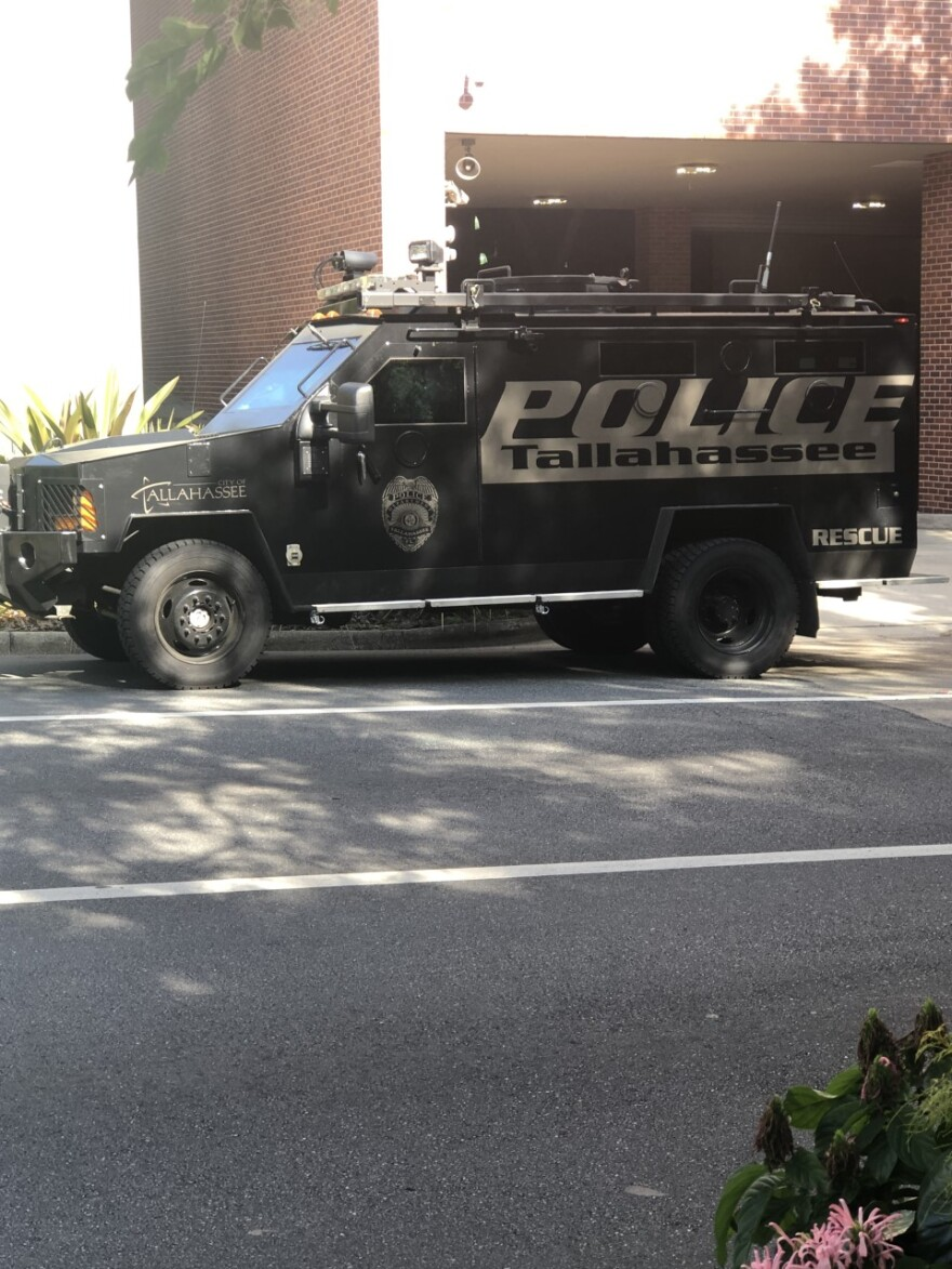 A black, armored truck behind City Hall in downtown Tallahassee