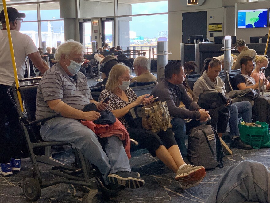 Tampa airport airline passengers with face masks for protect from coronavirus.