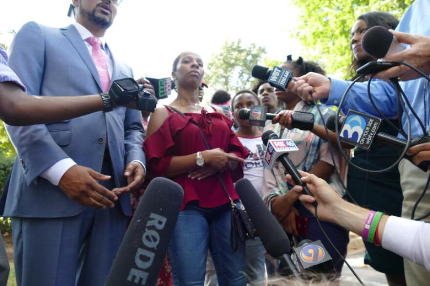 FILE: Rakeyia Scott addressed reporters at the north Charlotte apartment complex where her husband was shot in September 2016.