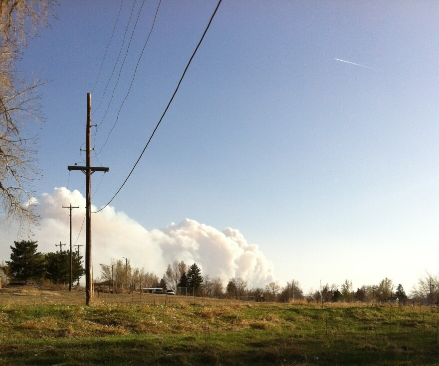 Smoke plumes above the Lower North Fork Fire in Jefferson County