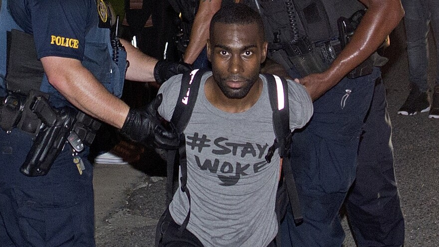 Police say DeRay Mckesson was blocking a road and placed officers him under arrest during a protest in Baton Rouge, La., in July 2016. On Thursday a federal judge threw out a lawsuit by an officer who said he was injured during the demonstration.