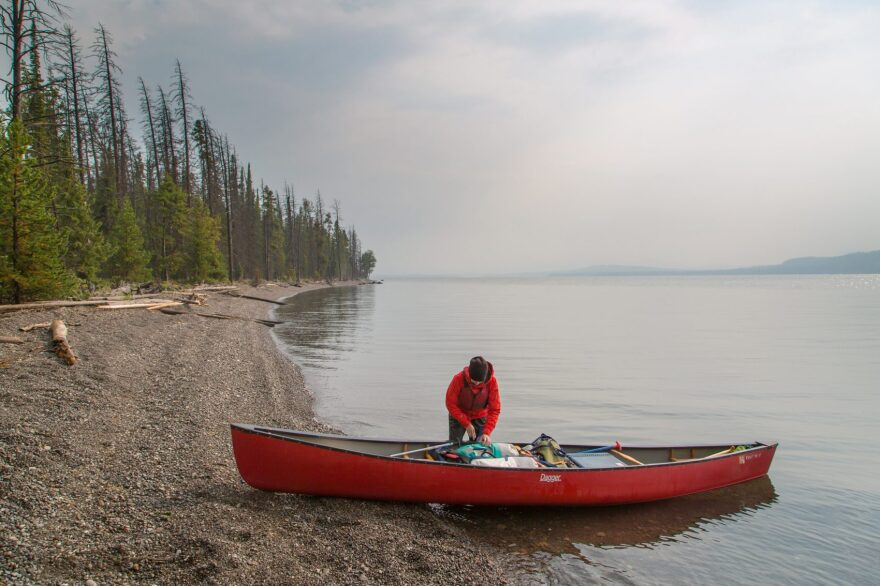 A canoeist on the southeast arm of Yellowstone Lake. (Neal Herbert, National Park Service)