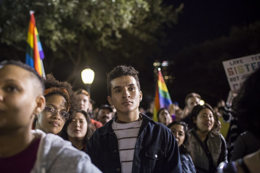 Skye Caleb Gill and other activists listen to speakers at a human rights rally at the Texas Capitol following President Trump's inauguration in 2017.