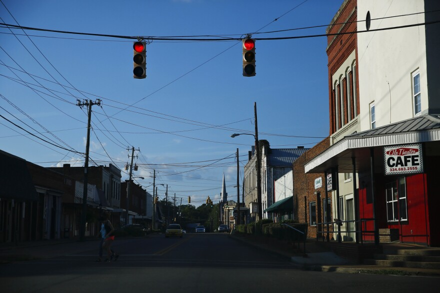 Two residents cross one of the main streets in downtown Marion, Ala., Wednesday, Aug. 24, 2016. Stretching from east Texas to southern Virginia, the impoverished area known as the Black Belt is heavily populated by blacks. (AP Photo/Brynn Anderson)