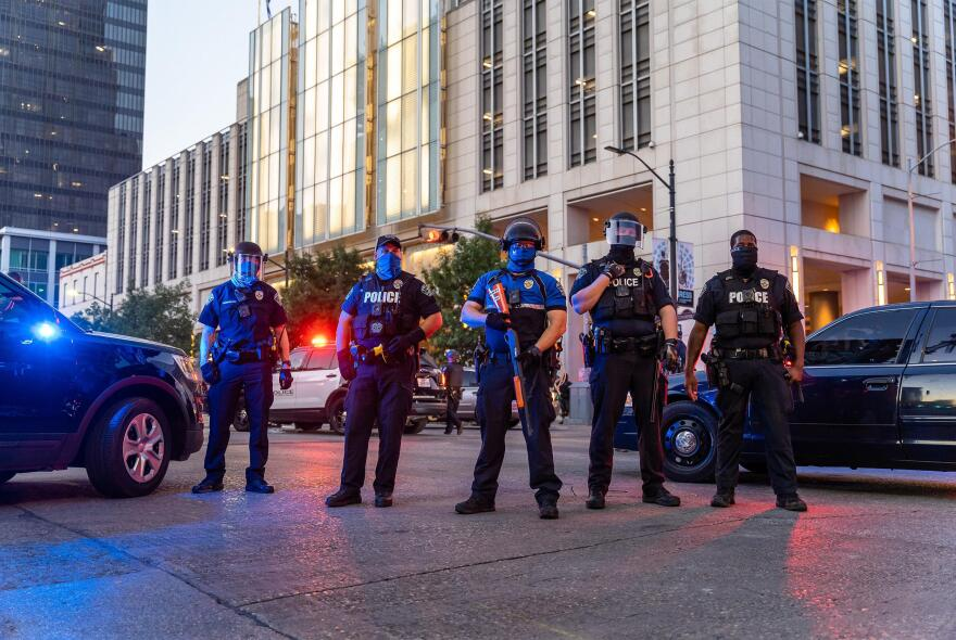Protesters clash with police in riot gear in downtown Austin on Aug. 1.