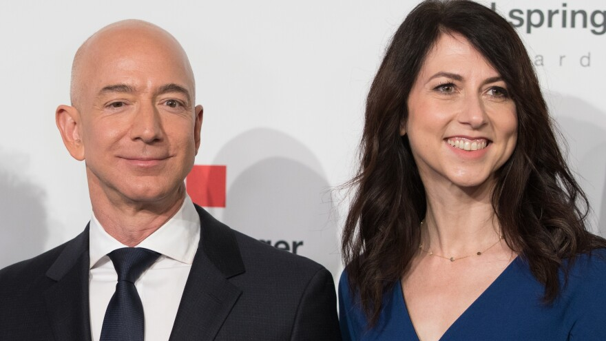 MacKenzie Bezos, one of the wealthiest women in the world, says she'll give at least half her fortune to charity. She's seen here in April 2018 with her now-former husband, Amazon founder Jeff Bezos.