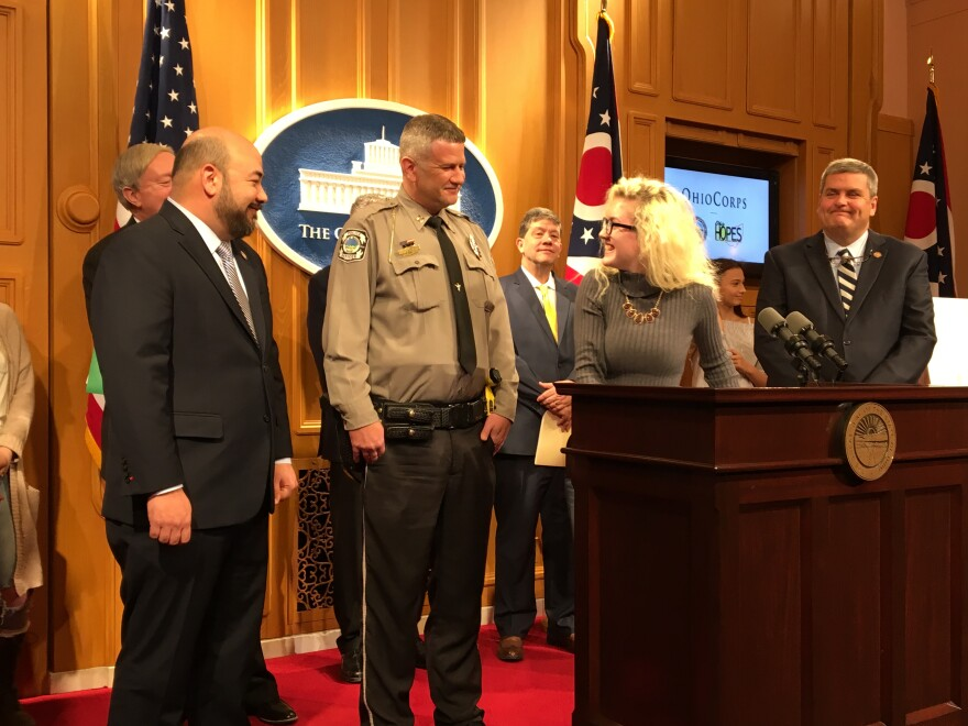 photo of Daisy Tolliver with Dennis Crabrtree, Cliff Rosenberger and Scott Ryan