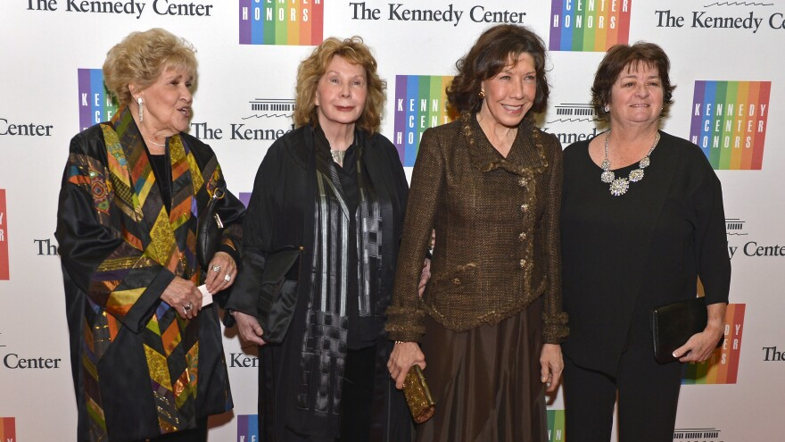 Actress Lily Tomlin (second from right) poses with wife writer Jane Wagner (second from left) and friends Elaine Barbour (left) and Vivian Schneider before the 2014 Kennedy Center Honors in Washington.