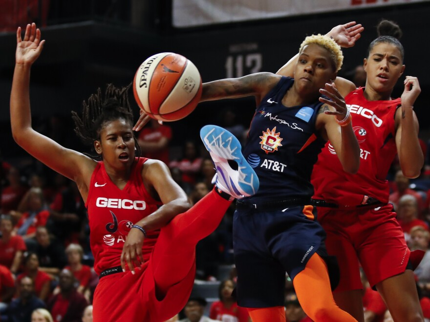 The Washington Mystics play in Game 5 of basketball's WNBA Finals in October. The league, which postponed the start of its season due to the coronavirus, announced plans to reopen in July.
