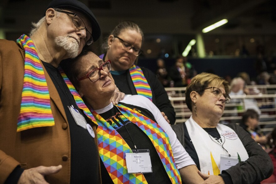 Ed Rowe, left, Rebecca Wilson, Robin Hager and Jill Zundel, react to the defeat of a proposal that would allow LGBT clergy and same-sex marriage within the United Methodist Church. (Sid Hastings/AP)