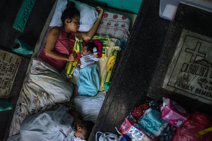 In 2017 at age 17, Ralyn Ramirez, her partner and their first child rest in a mausoleum at the Manila North Cemetery, where several thousand people live.