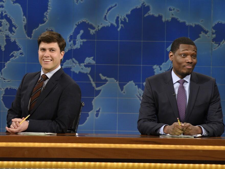 "Colin Jost and Michael Che co-anchor <em>SNL's</em> ""Weekend Update"" segment."