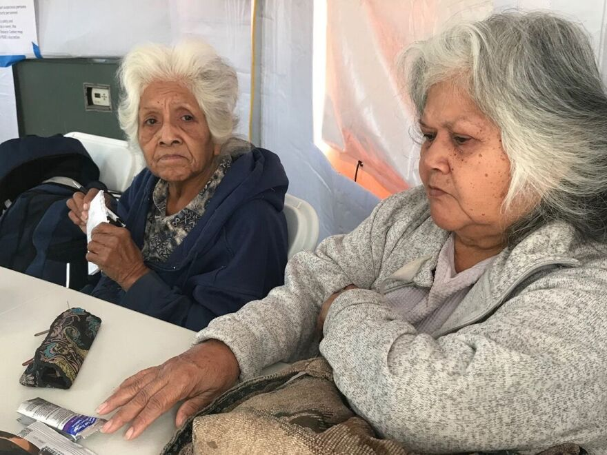 During recent blackouts in California, people like Fern Brown (left) and her sister, Lavina Suehead, came to a pop-up community center at the Auburn, Calf., fairgrounds to use electricity. Brown, 81, needed a treatment for her chronic lung condition.