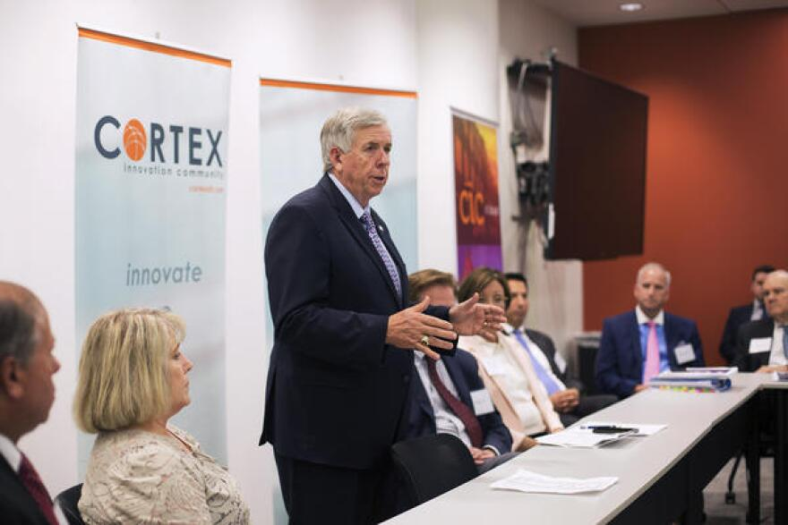 Gov. Mike Parson greets attendees at a meeting at Cortex Innovation Community in June.