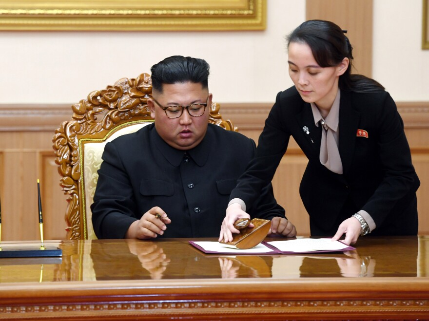 Kim Yo Jong helps her brother, North Korean leader Kim Jong Un, sign a joint statement following a summit with South Korean President Moon Jae-in in Pyongyang, North Korea, on Sept. 19, 2018.