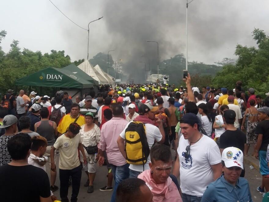 An aid trucks burns on the bridge between Venezuela and Colombia.