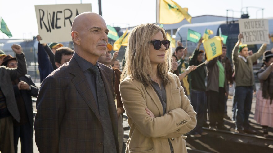 Billy Bob Thornton as Pat Candy and Sandra Bullock as Jane in a scene from <em>Our Brand is Crisis</em>.
