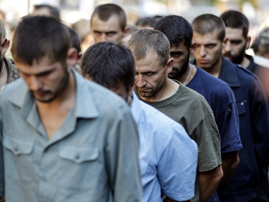 Ukrainian army prisoners of war are marched through  rebel-held Donetsk, Ukraine, in a counter-move to a parade in Kiev to mark the country's independence day.