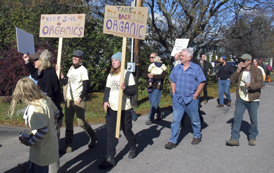Organic farmers who grow their crops in soil participate in a protest in Stowe, Vt., in 2015. Critics say the organic label is at essence about the health of soil, and did not want to allow crops raised in hydroponic systems to be labeled organic. Their efforts to strip hydroponic vegetables of the organic label failed this week.
