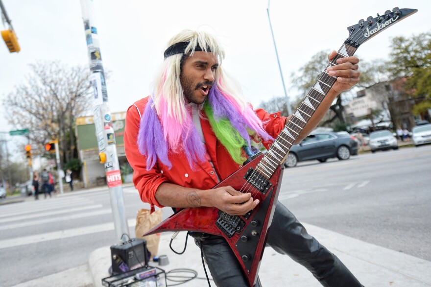 A musician plays on the street in Austin on the opening day of the 2015 South by Southwest music festival.