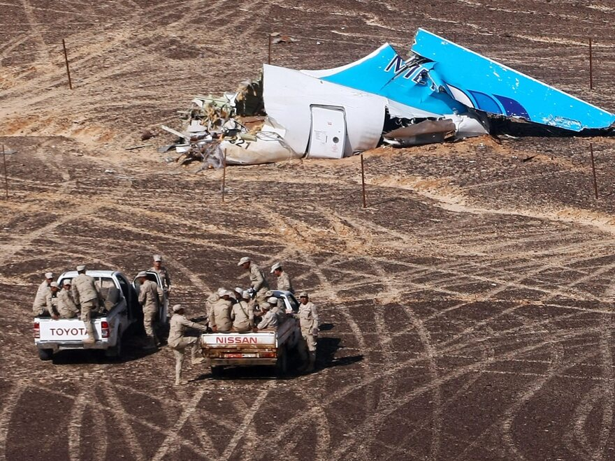 Egyptian military vehicles approach the wreckage of a Russian passenger jet bound for St. Petersburg, Russia, on Nov. 1 after it crashed in Egypt's Sinai peninsula.
