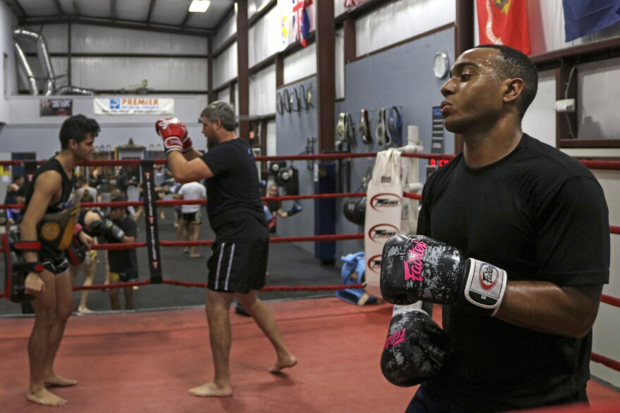 Kylen Henry, 25, spars with Ruff Hieras while Austin Amell and Marcus Kampfe train behind him