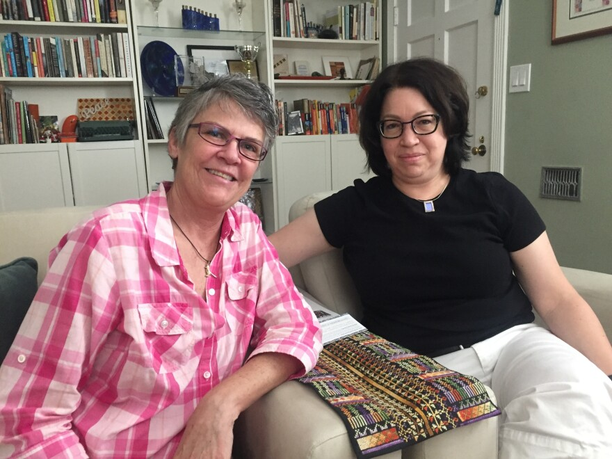Phoenix residents Laurie Provost (left), 53, and Maddie Adelman, 50, have watched their city become increasingly welcoming toward the LGBTQ community over the last two decades, even as their state has kept in place anti-LGBTQ policies and laws.