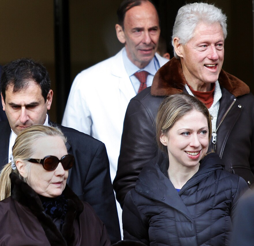 Wednesday: Secretary of State Hillary Clinton (in sunglasses) as she left New York Presbyterian Hospital with her husband, former president Bill Clinton (top right), and their daughter, Chelsea.