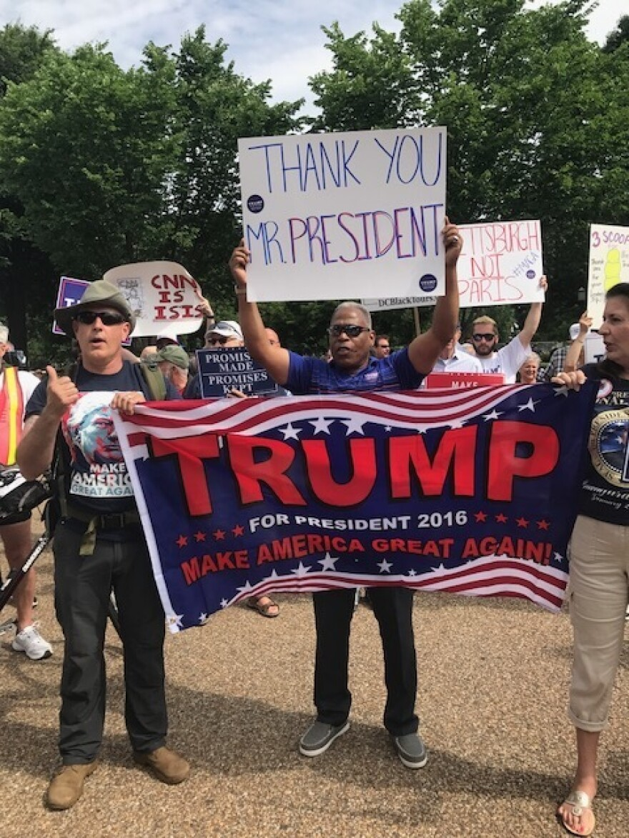 """Across the street from March For Truth demonstrators, Trump supporters staged their own, smaller, """"Pittsburgh Not Paris"""" event in D.C. to show support of President Trump's decision to withdraw from the Paris climate agreement."""