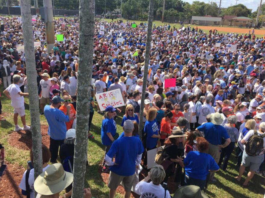 Thousands of people gather at the baseball fields behind City Hall in Boca Raton to start the March For Our Lives event there Saturday morning.