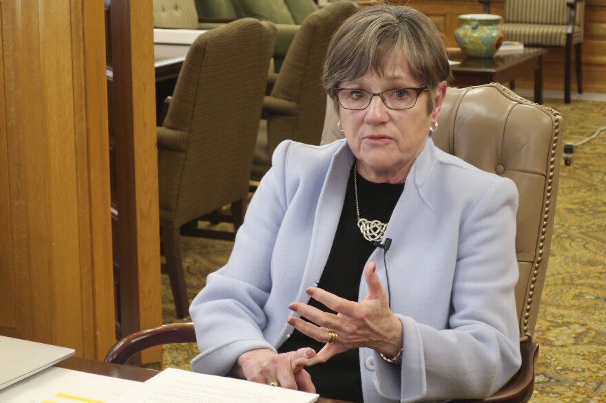 Kansas Gov. Laura Kelly answers questions about the coronavirus in March. On the day before Easter, the state Supreme Court upheld her executive order limiting the size of church services to mitigate the spread of the virus.