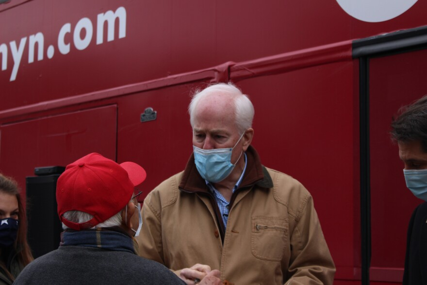 John Cornyn in front of his campaign bus.