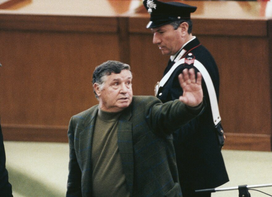 """Salvatore Riina, aka """"Toto,"""" the most important figure of the Sicilian mafia, is brought to justice after evading police for 23 years at the Aula Bunker of Palermo courthouse on March 4, 1993 in Palermo, Italy."""