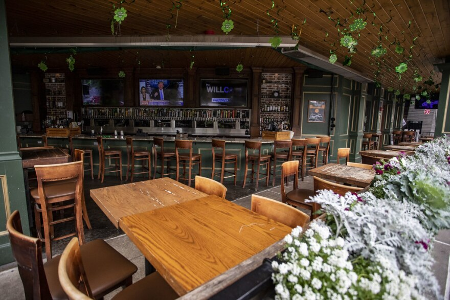 The patio of a restaurant in The Domain is empty during lunchtime on March 16.
