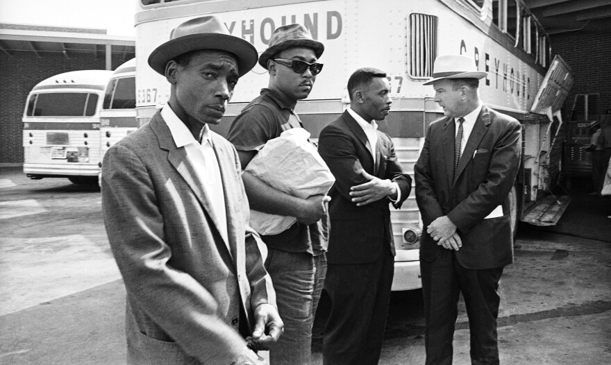 The Reverse Freedom Riders Eddie Rose, Almer Payton and Willie Ramsey are shown with Citizens Council director George Singlemann.