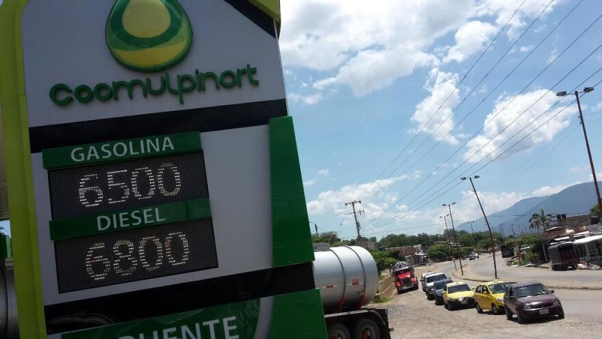 A gas station belonging to a chain operated by a business co-op, in the Colombian border city of Cúcuta, lists regular gas at 6,500 pesos ($1.75) and diesel at 6,800 pesos ($1.84) per gallon.