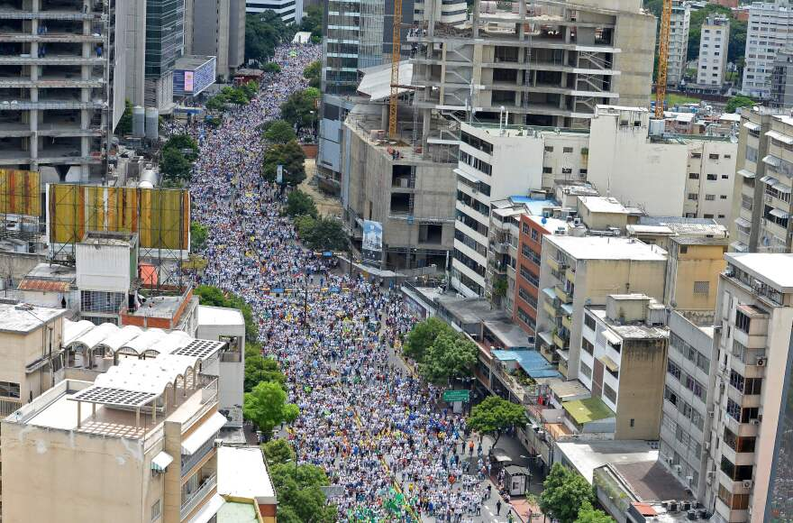 Activists opposed to Venezuelan President Nicolas Maduro march in Caracas on Thursday. The opposition and the government headed into a crucial test of strength with massive marches for and against a referendum to recall Maduro.