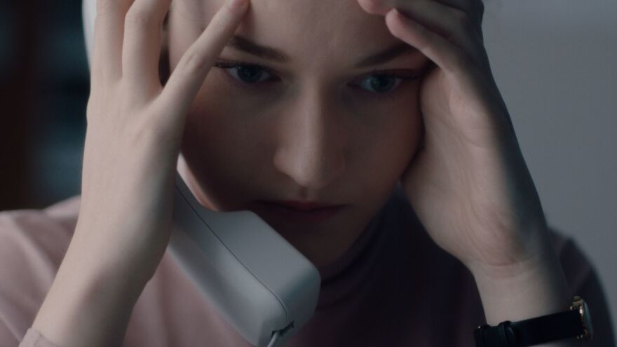 Jane (Julia Garner) slowly comes to realize something terrible about her boss in Kitty Green's <em>The Assistant.</em>
