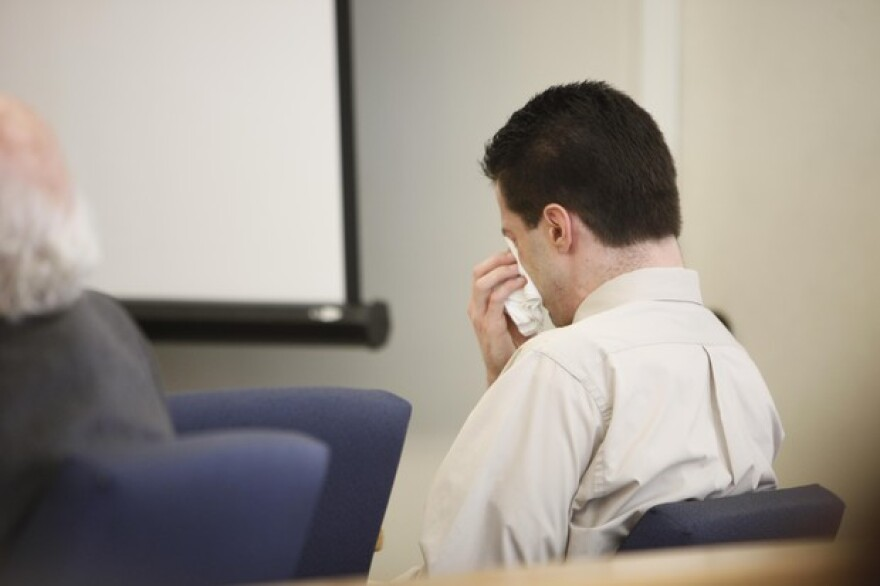 <p>Nicholas McGuffin sheds tears at his trial in 2011.&nbsp;</p>