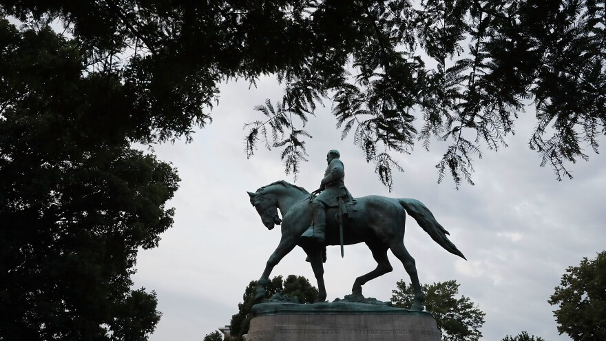 The statue of Confederate Gen. Robert E. Lee seen in Charlottesville, Va.'s Emancipation Park one day after a white nationalist rally that was organized to oppose its planned removal devolved into violence.