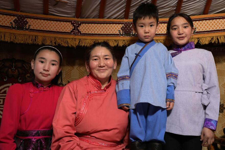 Chantsal Vaanjir (second from left), 46, arrived in Ulaanbaatar in 2001 seeking a job. The former herder now works as a cleaner, living in the <em>ger</em> district with her three school-age children: Uyanga Chantsal (from left), 13; Altanshagai Dorjsuren, 6; and Bujin Chantsal, 11.