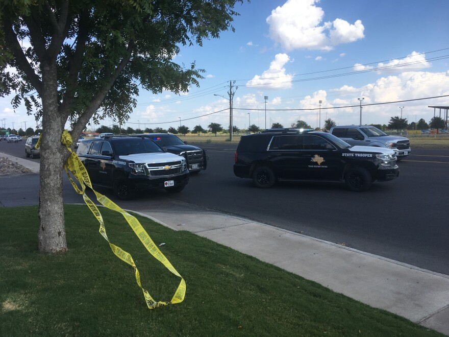 DPS troopers block the road at a shooting scene in Odessa, Texas.