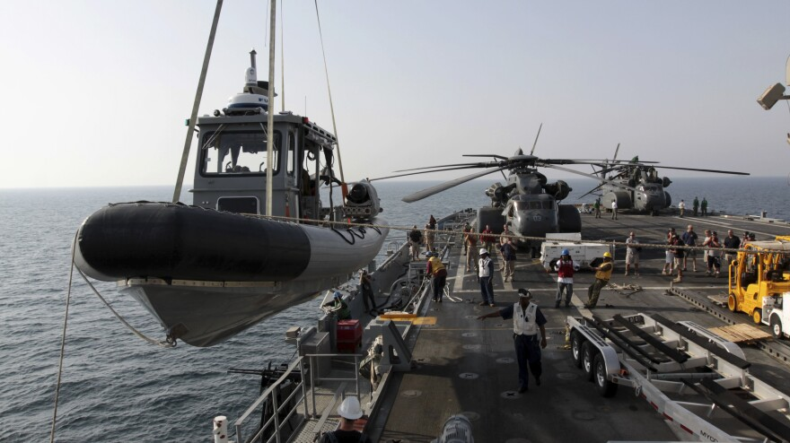 A U.S. Navy boat is lowered to the sea from the deck of the USS Ponce in the Persian Gulf on Sept. 22. More than 30 nations are participating in an exercise responding to simulated sea-mine attacks in international waters amid rising tension with Iran.